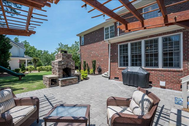 backyard stone fireplace and paver patio