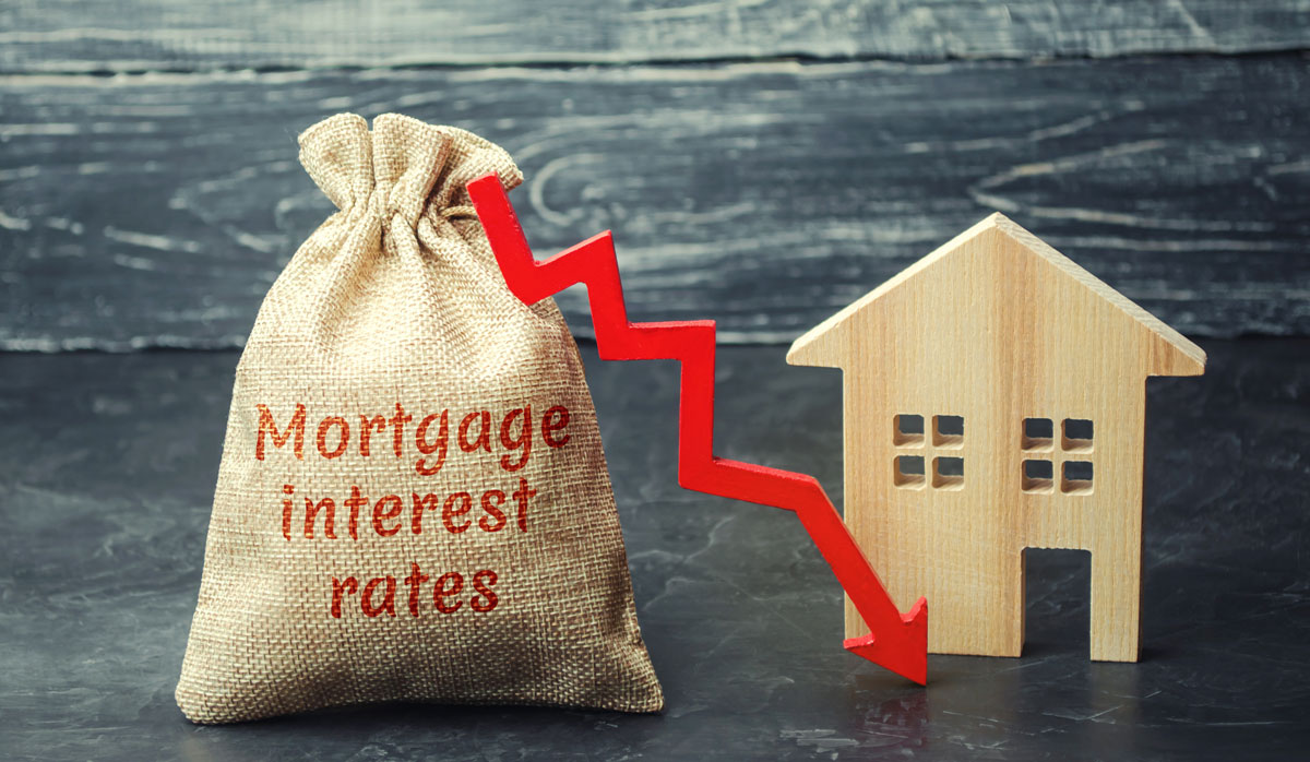 bag of money with words Mortgage interest rates with red arrow down and house